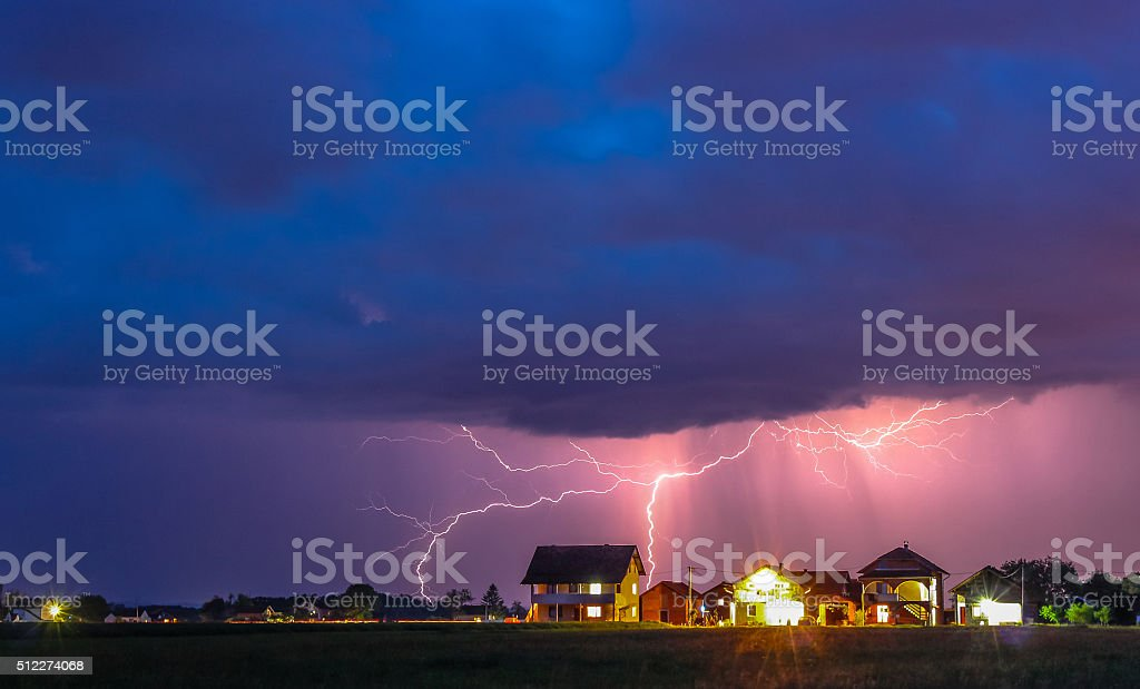 Thunderstorm with rain and lightning bolts stock photo