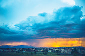 Thunderstorms hover over Colorado neighborhood at sunset