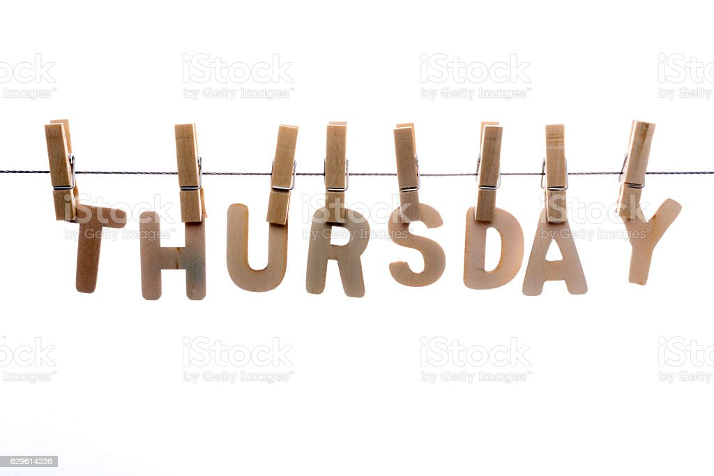 Thursday in wooden letters on clothesline stock photo