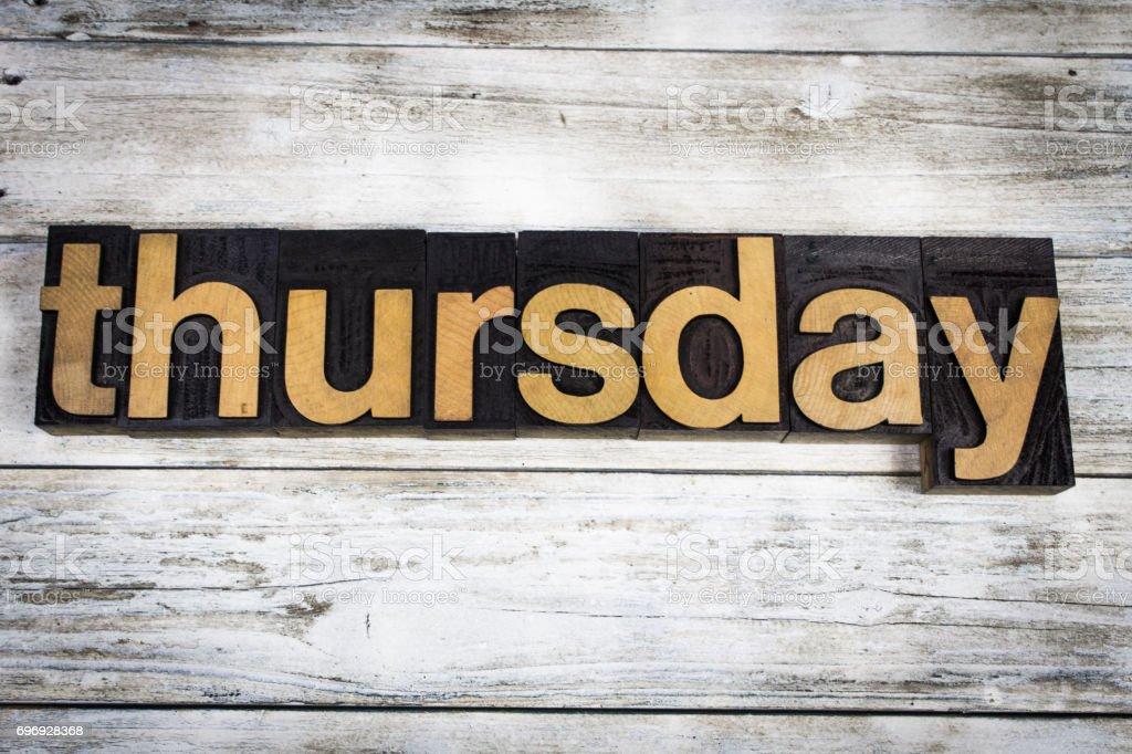 Thursday Letterpress Word on Wooden Background stock photo