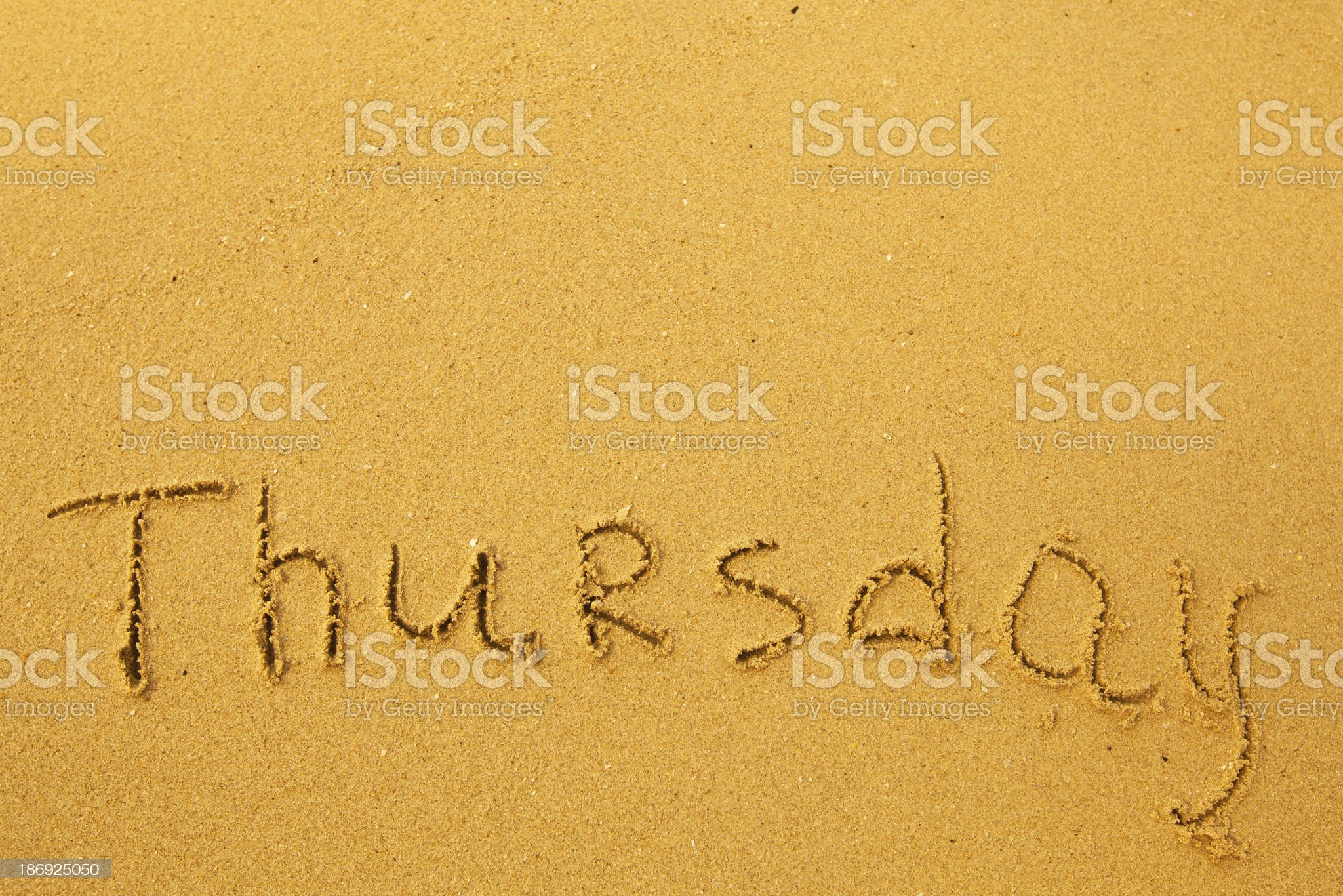Thursday - written in sand on beach texture. royalty-free stock photo