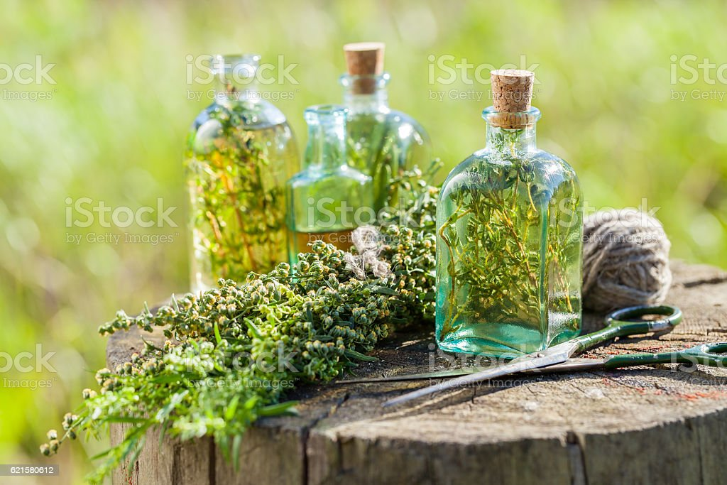 Thyme, estragon and rosemary essential oil or infusion stock photo
