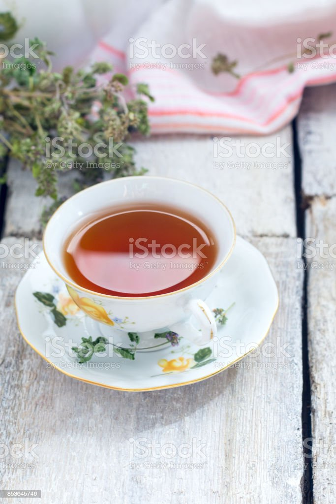 Thyme herbal tea on white wooden background, view from above, space for a text stock photo