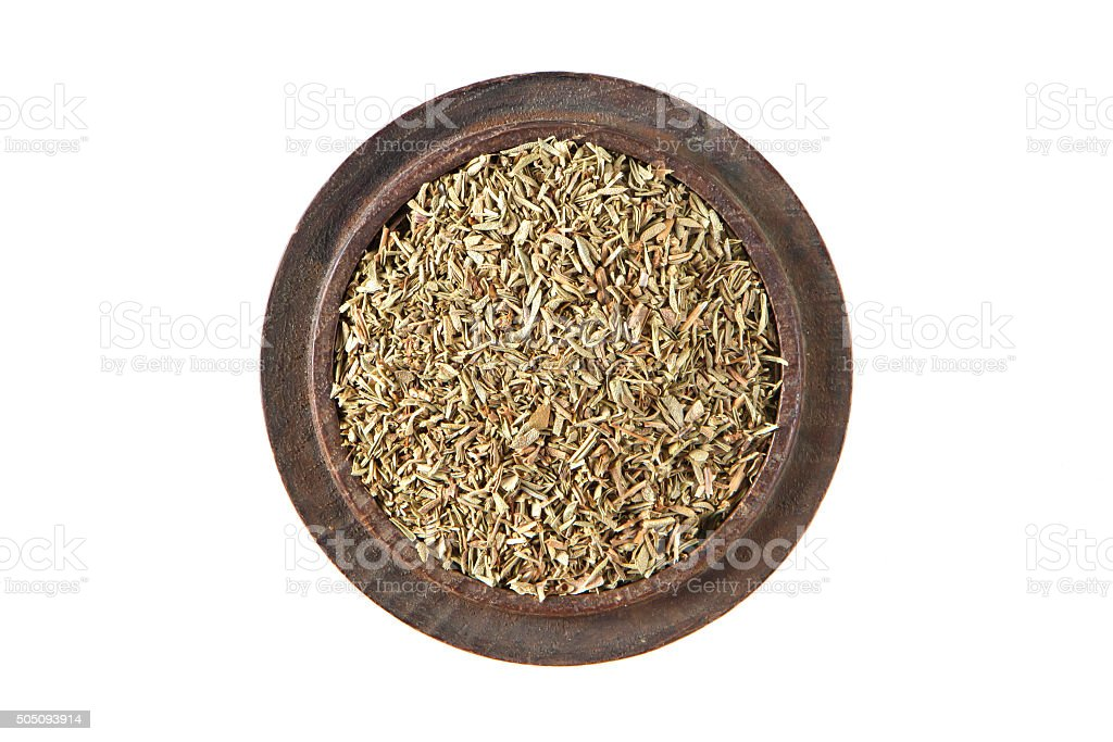 Thyme in wood bowl on isolated white., Top view stock photo