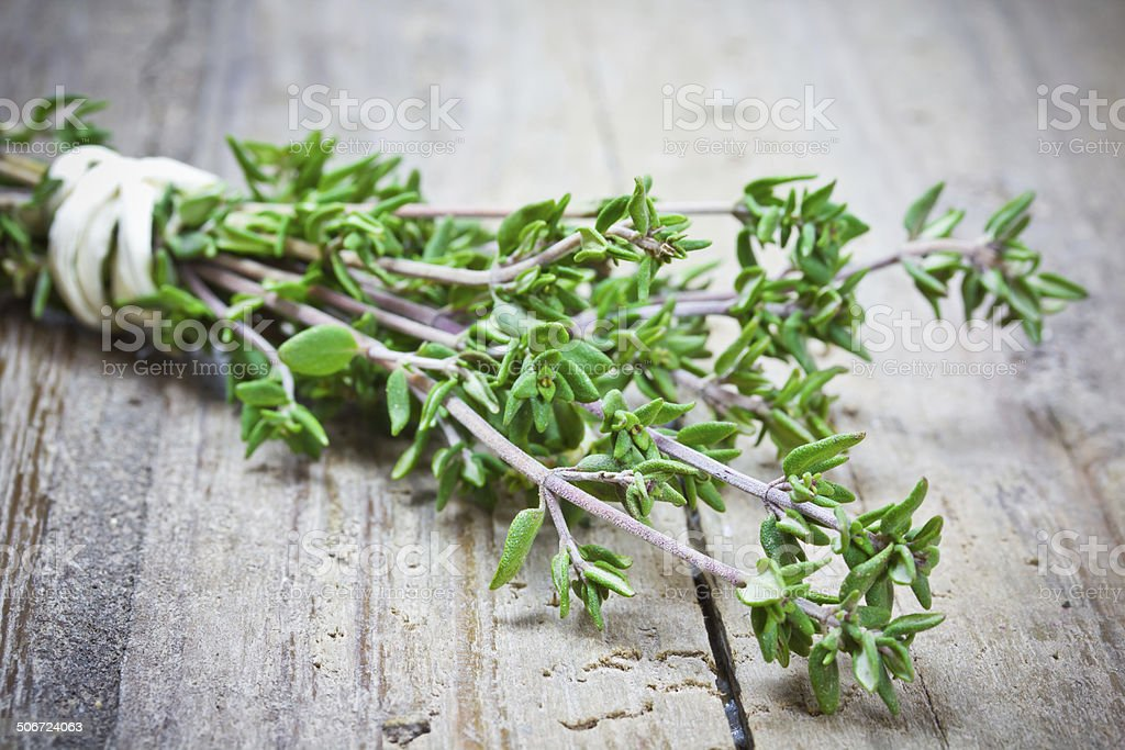 thyme on wooden table stock photo