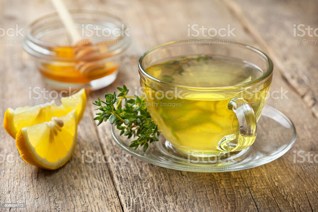 thyme tea in glass cup stock photo