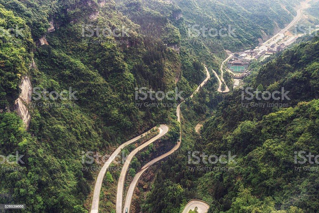 tianmen mountain winding road stock photo