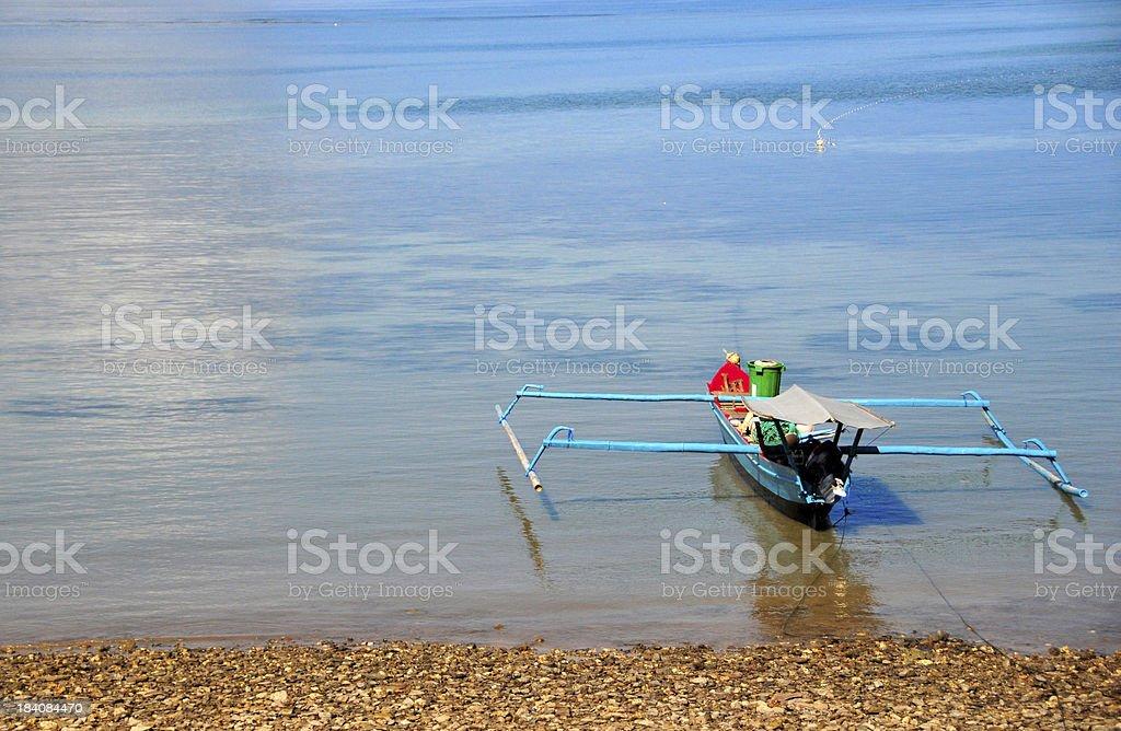 Tibar bay, East Timor: outrigger boat stock photo