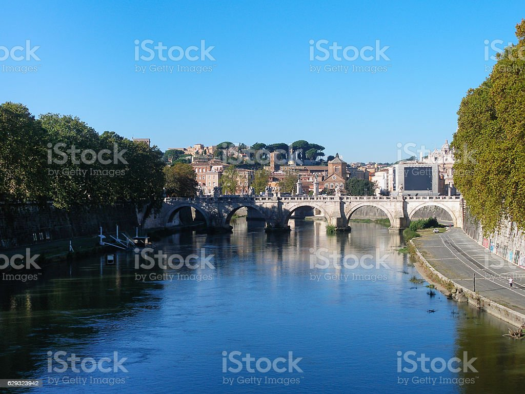 Tiber river and Bridge of Holy Angel in Rome stock photo