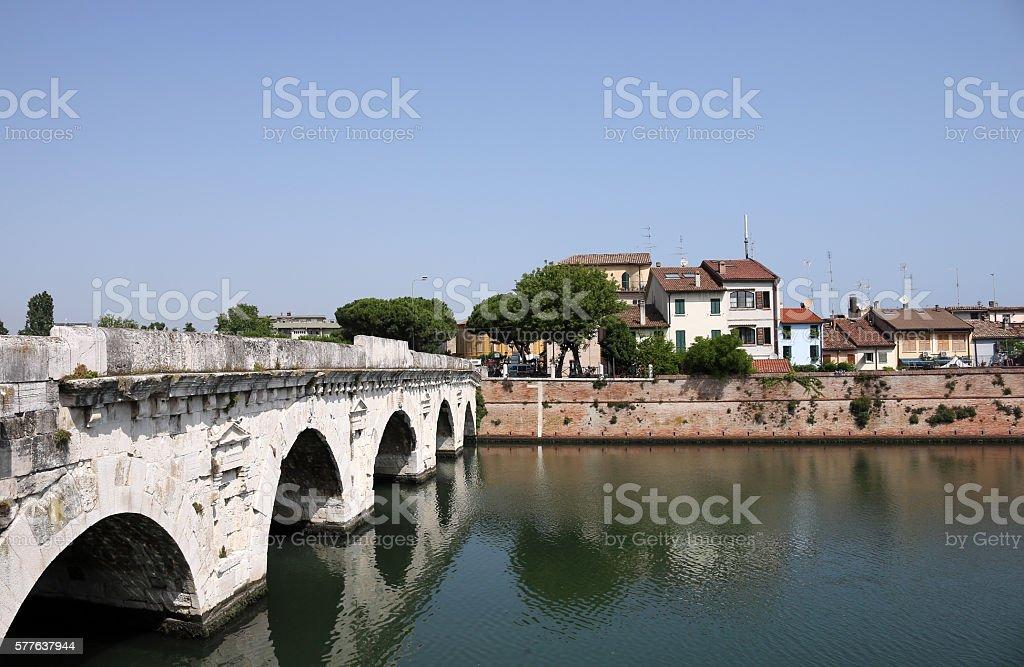 Tiberius bridge and old buildings Rimini Italy stock photo