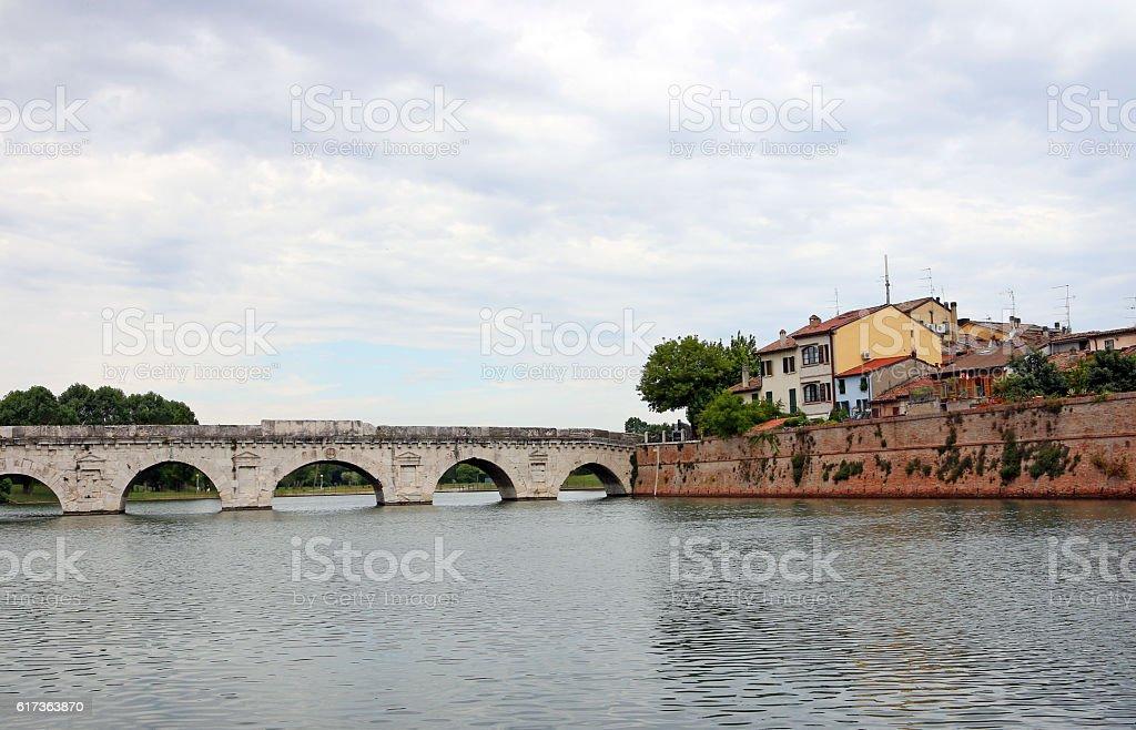 Tiberius bridge and old houses Rimini Italy stock photo