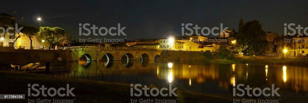 Tiberius bridge at night, Rimini stock photo
