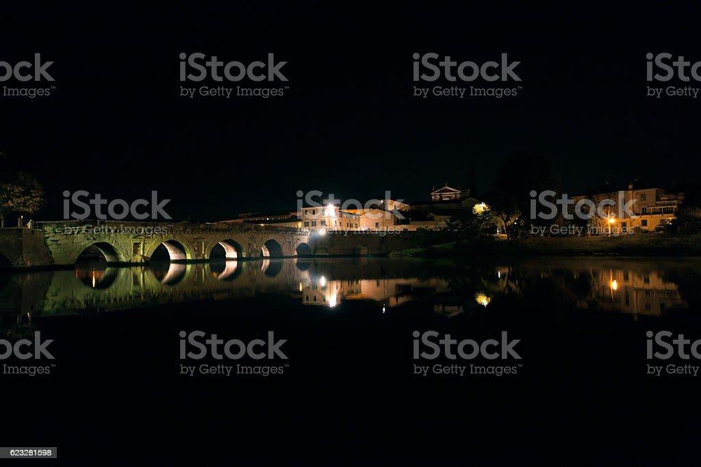 Tiberius Bridge of Rimini at night stock photo