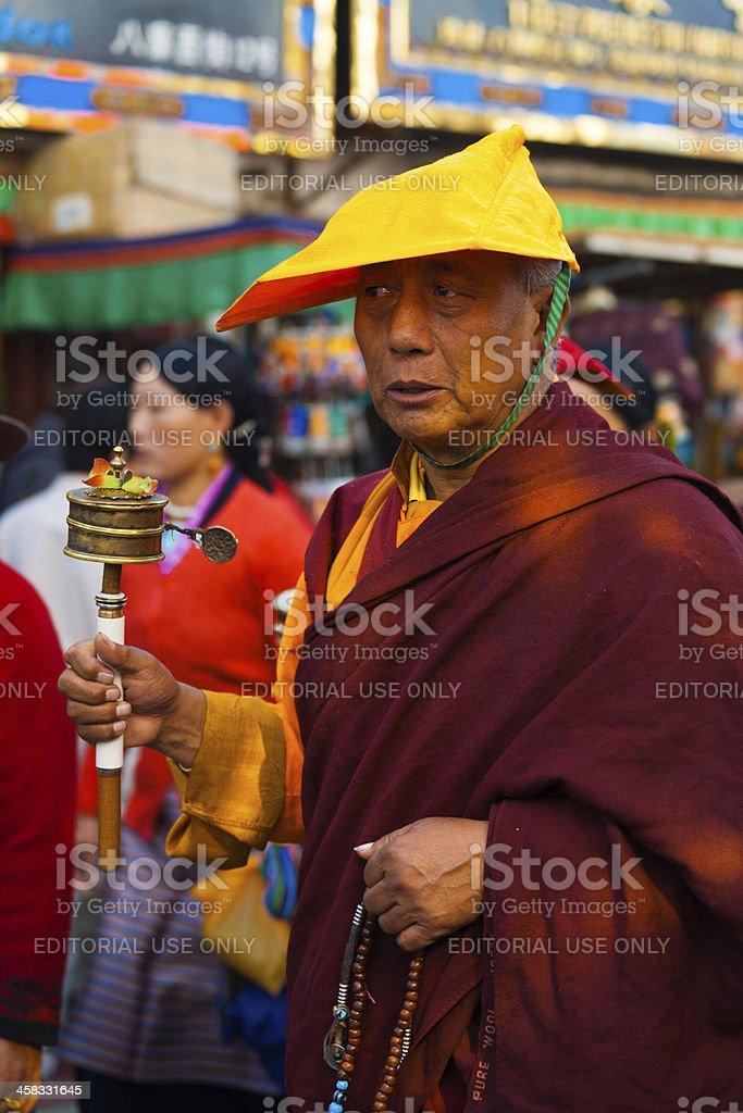 Tibetan Buddhist Monk Spinning Prayer Wheel royalty-free stock photo