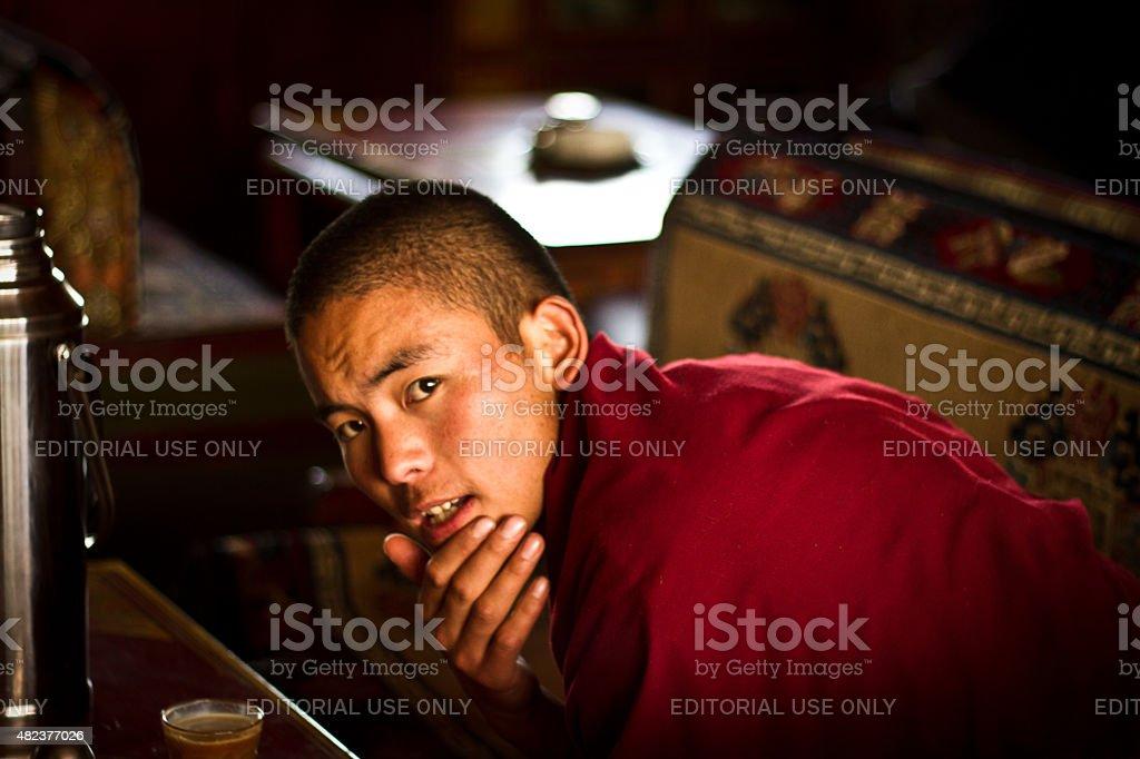 Tibetan Buddhist monk with tea in Lhasa Tibet stock photo