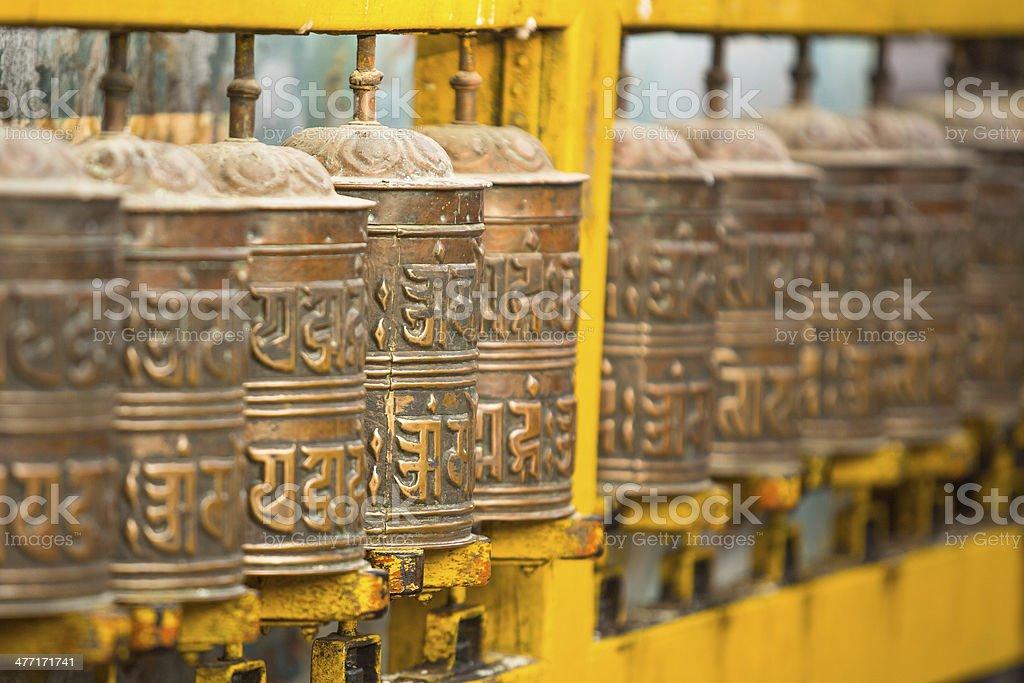 Tibetan Buddhist prayer wheels at Boudhanath stupa in Kathmandu stock photo