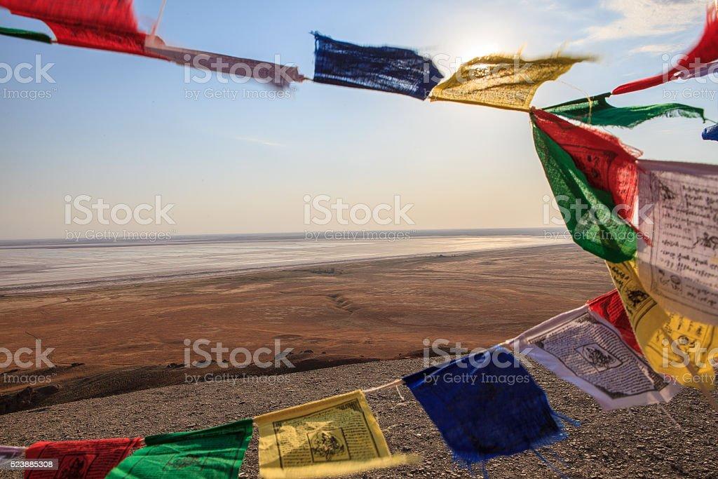 Tibetan Buddhist prayerful flags and the desert landscape stock photo