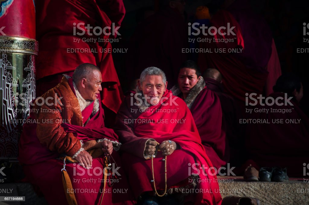 Tibetan Buddist monks is debating at Sichuan Buddhist College stock photo
