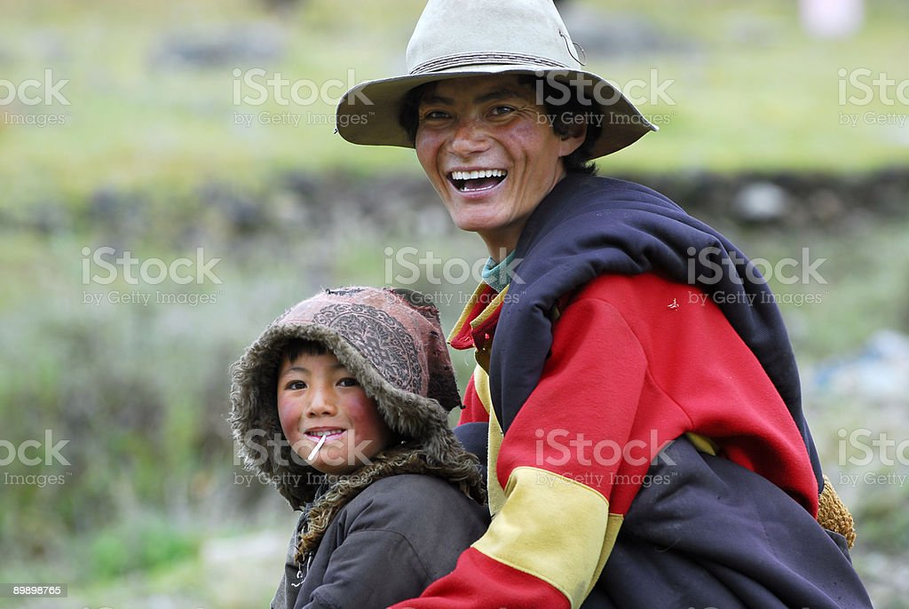 Tibetan father and son stock photo