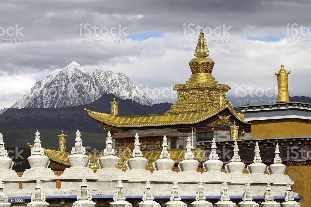 Tibetan golden temple and snow mountain royalty-free stock photo