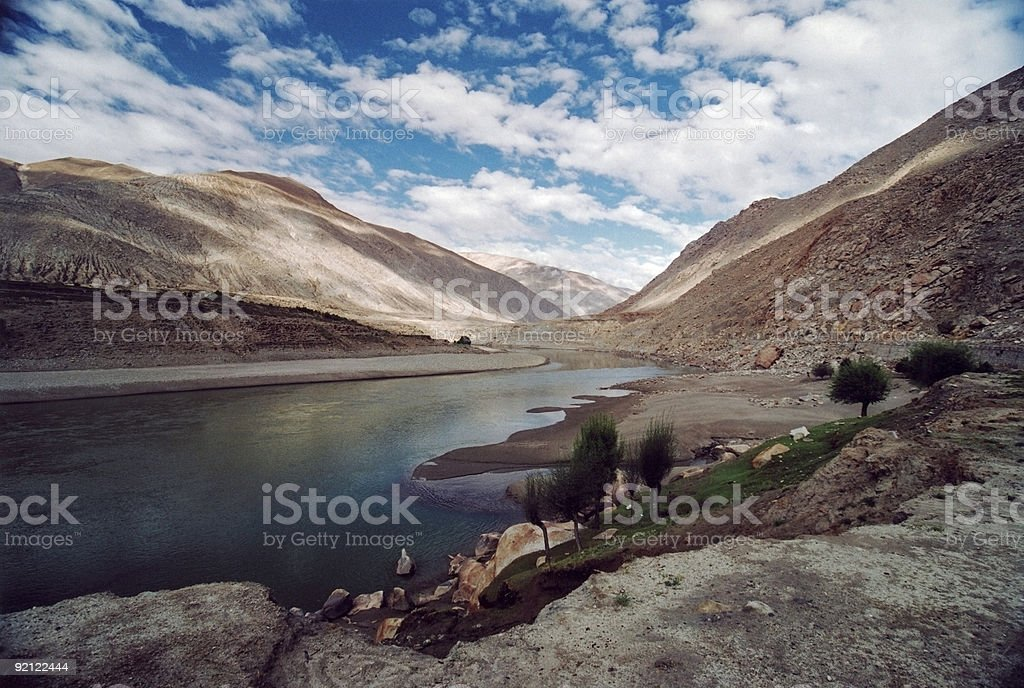 Tibetan landscape with clouds and river Brahmaputra stock photo