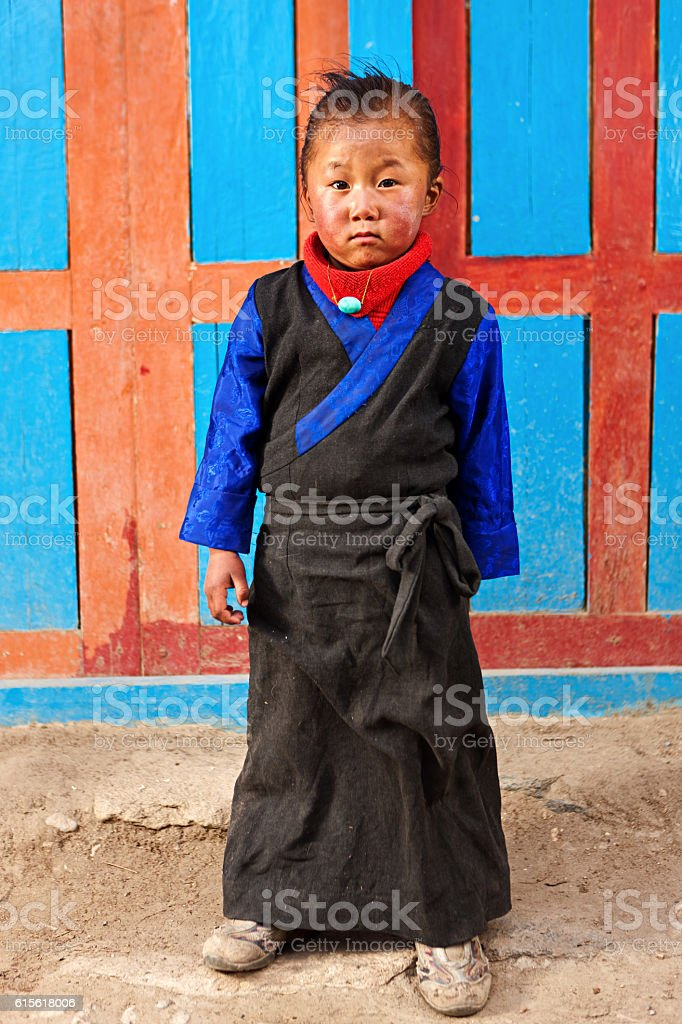 Tibetan little girl in traditional clothing. Mustang, Nepal stock photo