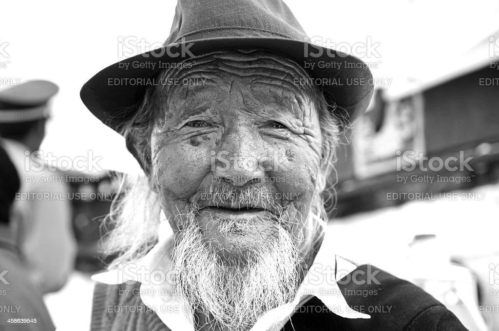 Tibetan man outside Johkkan Temple. royalty-free stock photo