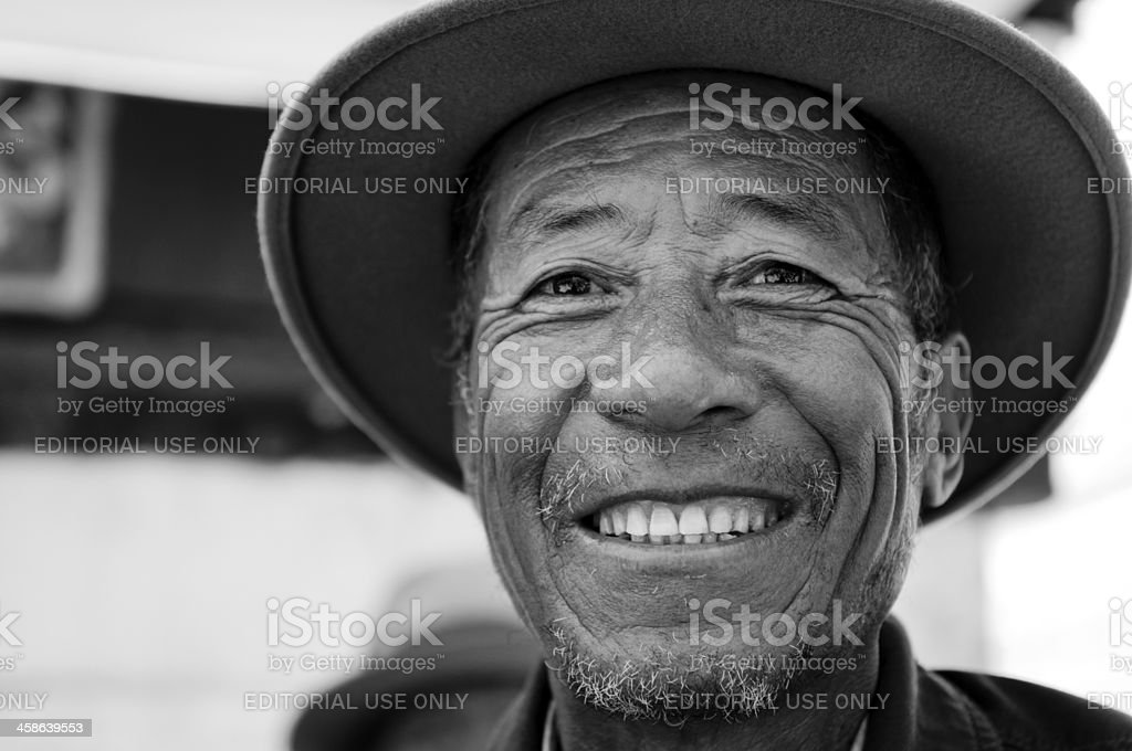 Tibetan man outside Johkkan Temple. stock photo