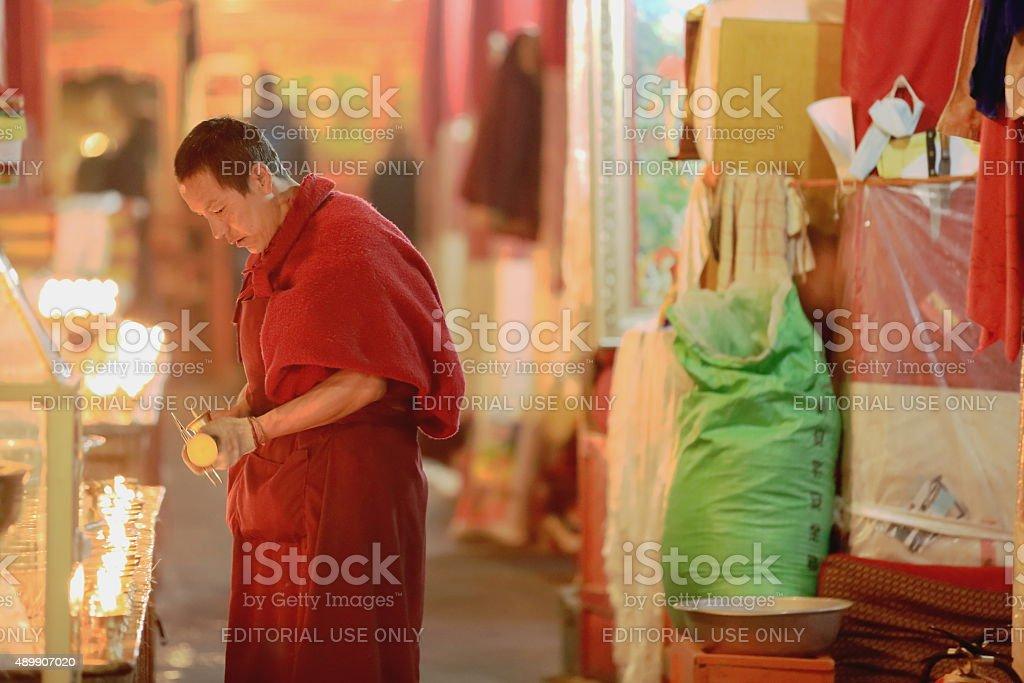 Tibetan monk and candles. Drepung monastery-Tibet. 1232 stock photo
