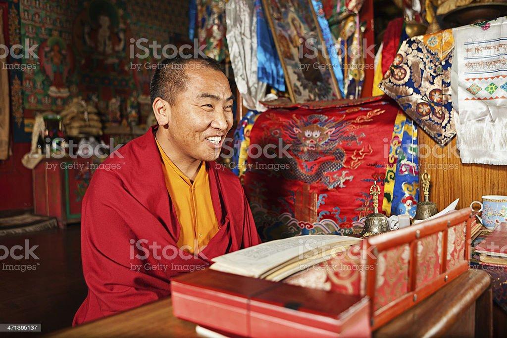 Tibetan monk praying during puja stock photo
