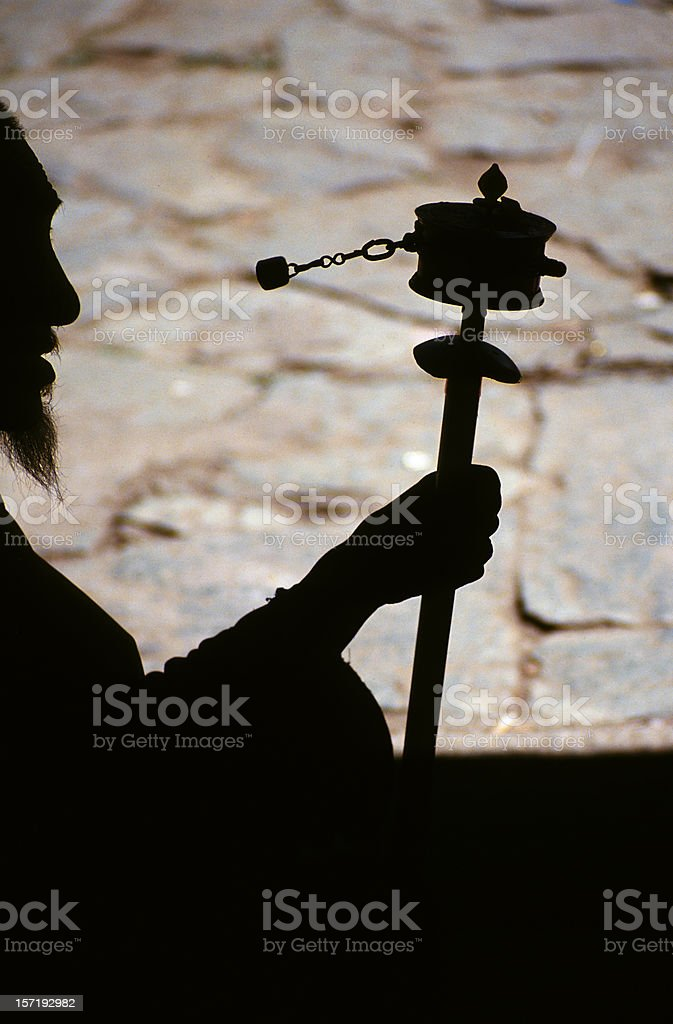Tibetan monk with prayer wheel royalty-free stock photo