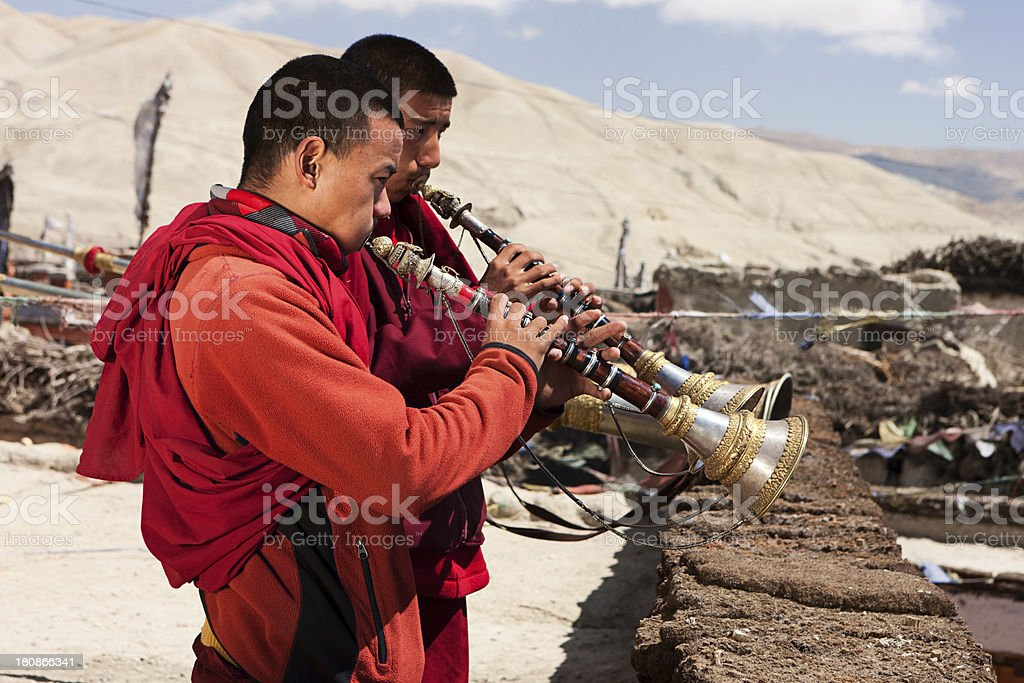 Tibetan monks playing buddhist horns royalty-free stock photo