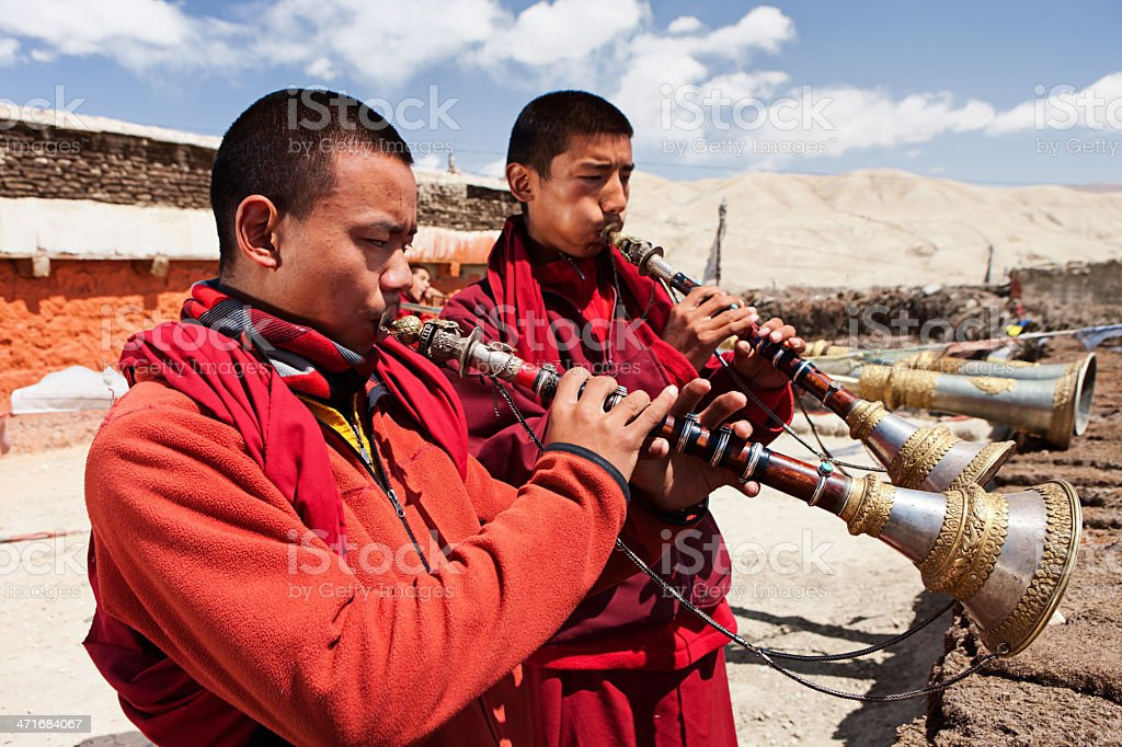 Tibetan monks playing buddhist horns royalty-free stock photo