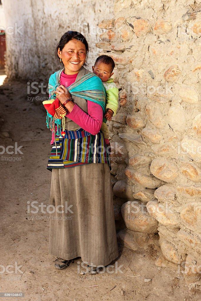 Tibetan mother carrying her baby, Upper Mustang stock photo