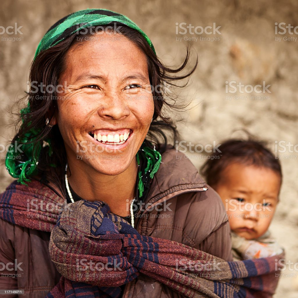 Tibetan mother carrying her child royalty-free stock photo