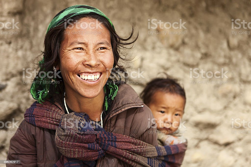 Tibetan mother carrying her child stock photo
