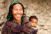 Tibetan mother carrying her child