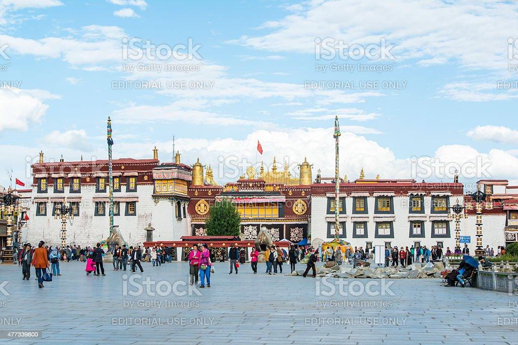 Tibetan pilgrims and tourists in front of Jokhang, Lhasa, Tibet. stock photo