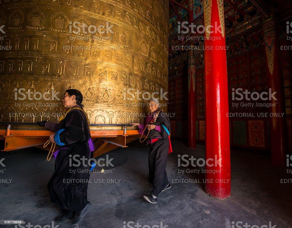 Tibetan pilgrims in Rongwo Monastery, Qinghai, Tibet stock photo