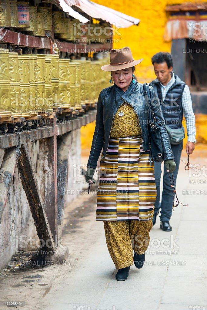 Tibetan pilgrims turning prayer wheels at Barkhor, Lhasa, Tibet stock photo