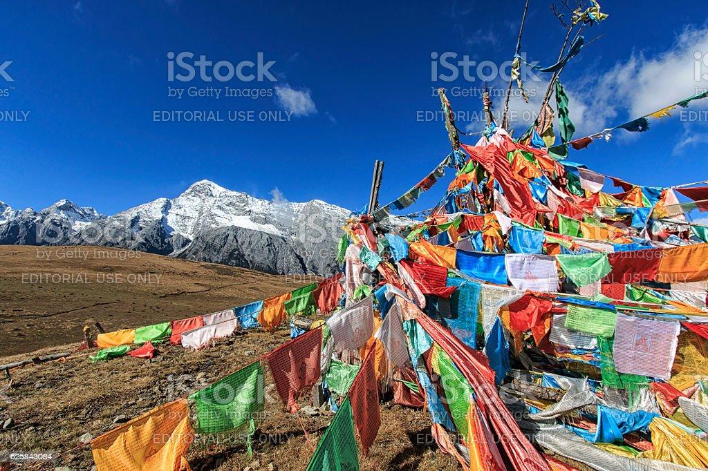 Tibetan Prayer Flags and Jade Dragon Snow Mountain stock photo