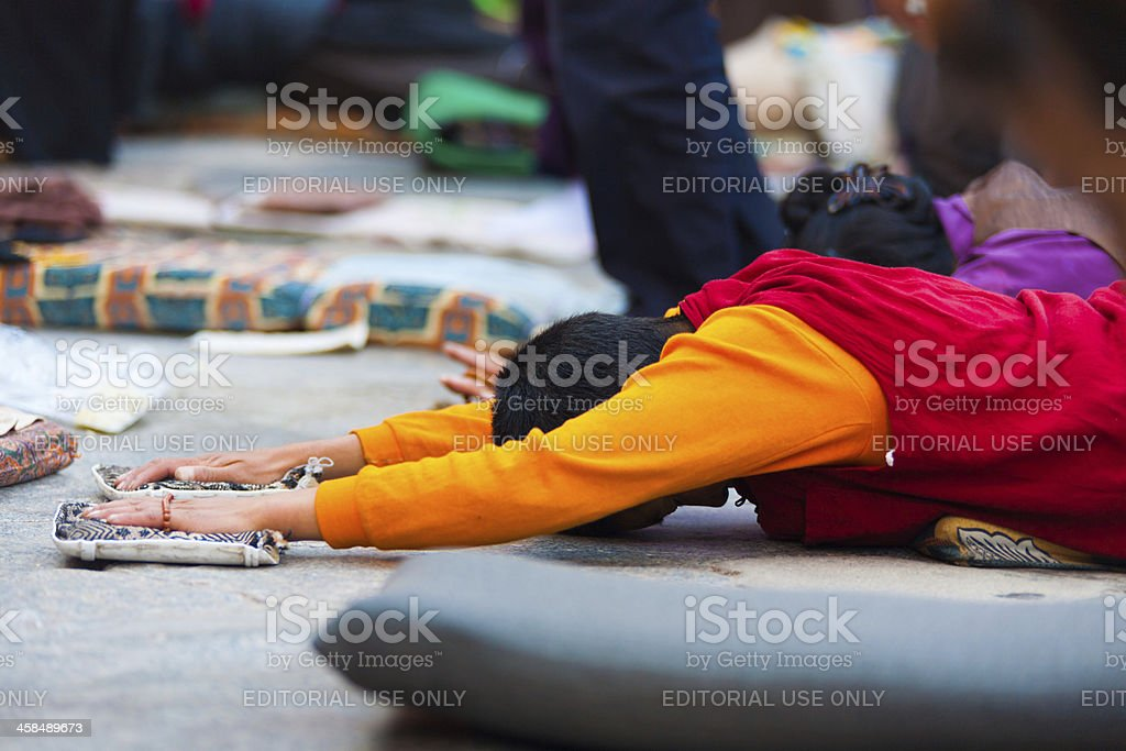 Tibetan Prostrating Outstretch Arms Flat Ground royalty-free stock photo