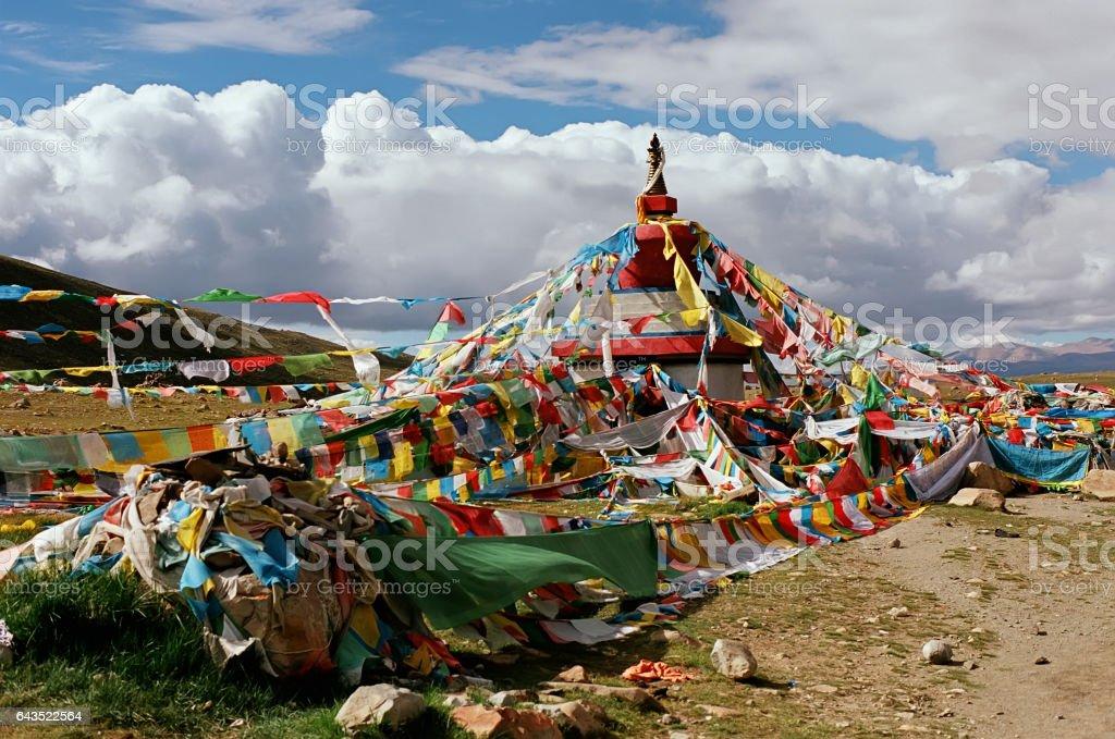 Tibetan ritual stupa and prayer flags. stock photo