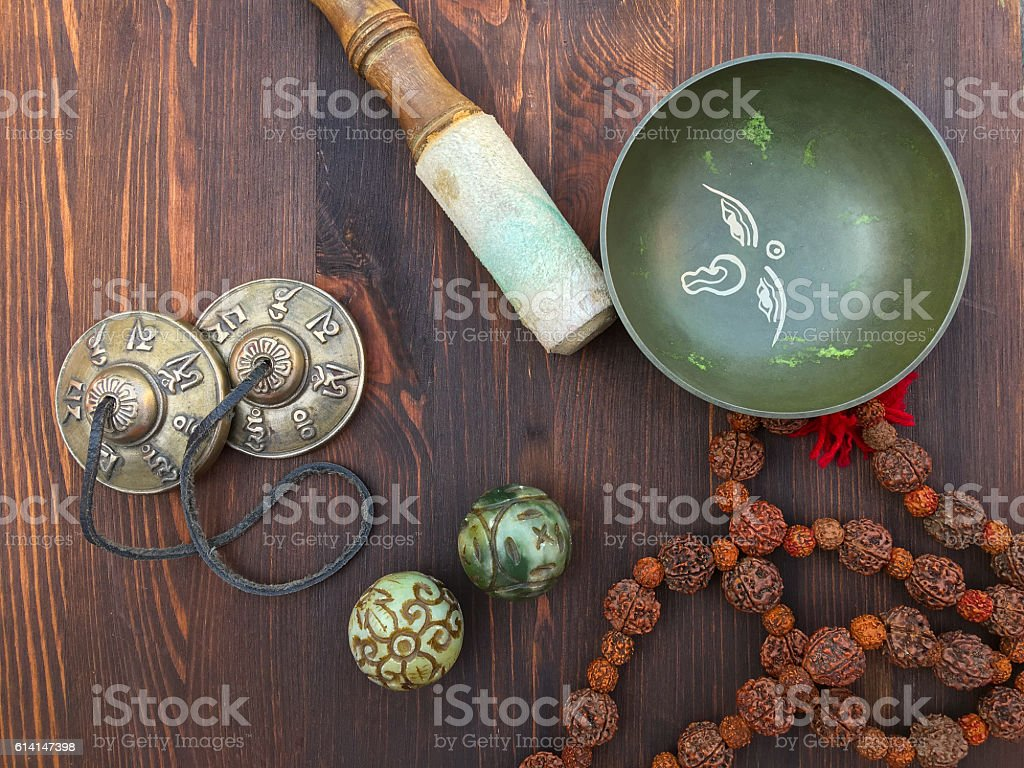 Tibetan singing bowl and objects for religious ritual stock photo