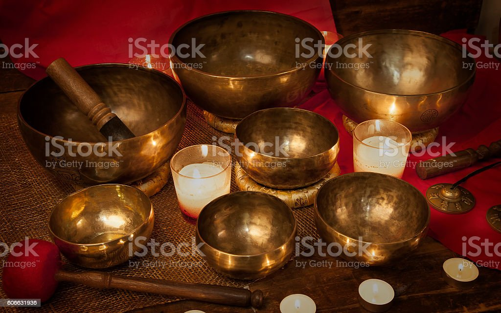 Tibetan singing bowls with candles stock photo