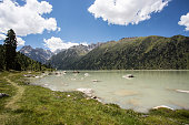 Tibetan stone tabletsin the waters of picturesque lake.