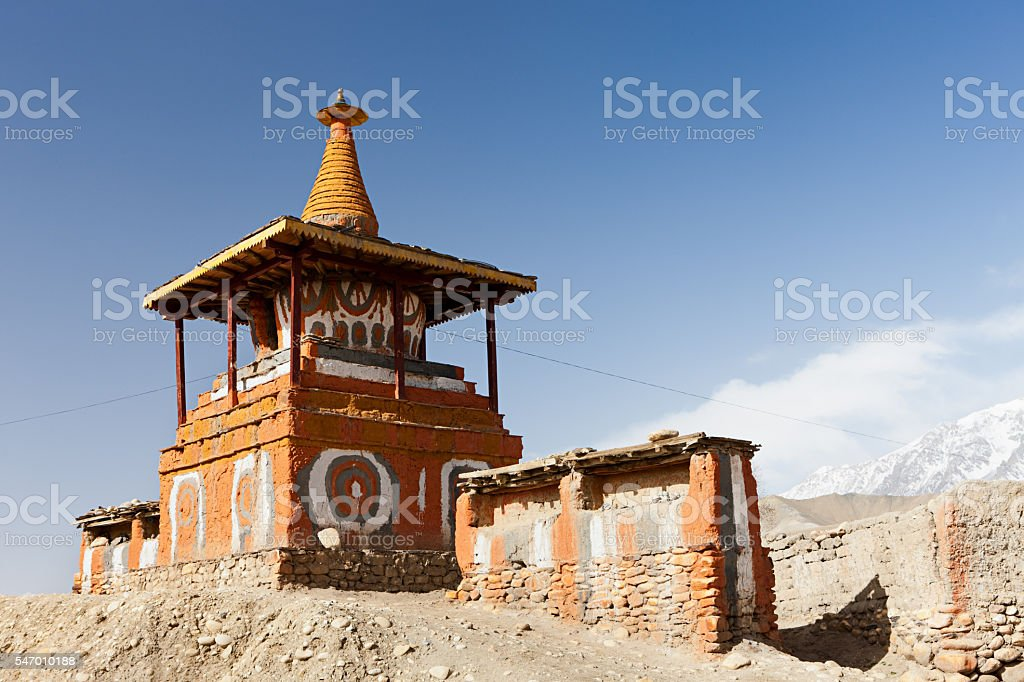 Tibetan stupa in Himalayan mountains. Mustang, Nepal. stock photo
