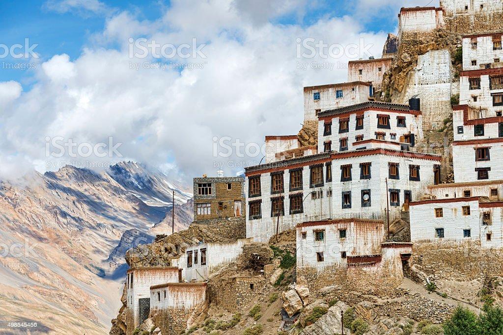 Tibetan style buildings located on edge of high rock stock photo