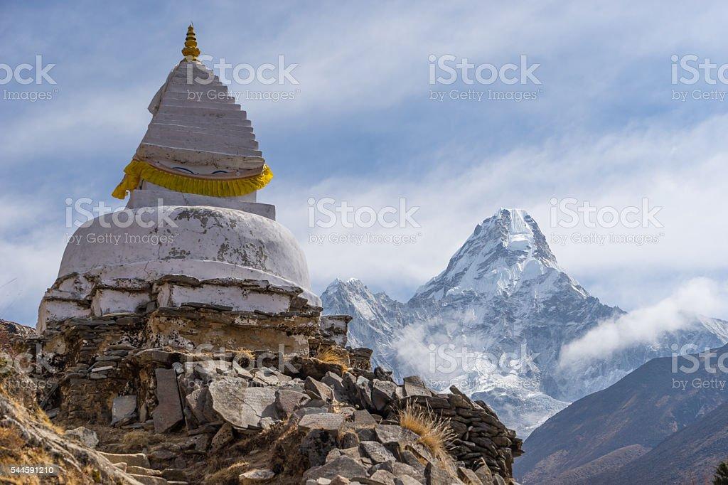 Tibetan style stupa and Ama Dablam mountain stock photo