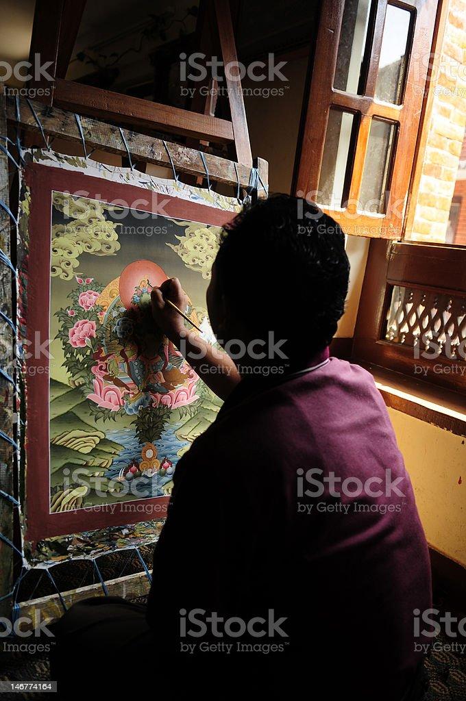 Tibetan Tangka painting at coloring stage stock photo